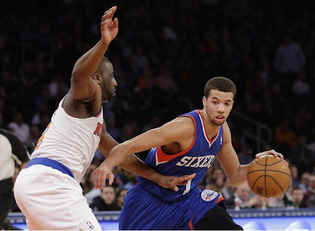 New York Knicks' Raymond Felton, left, defends Philadelphia 76ers' Michael Carter-Williams during the second half of an NBA basketball game Monday, March 10, 2014, in New York