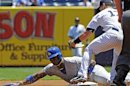 Los Angeles Dodgers' Yasiel Puig is tagged out by New York Yankees shortstop Jayson Nix in New York