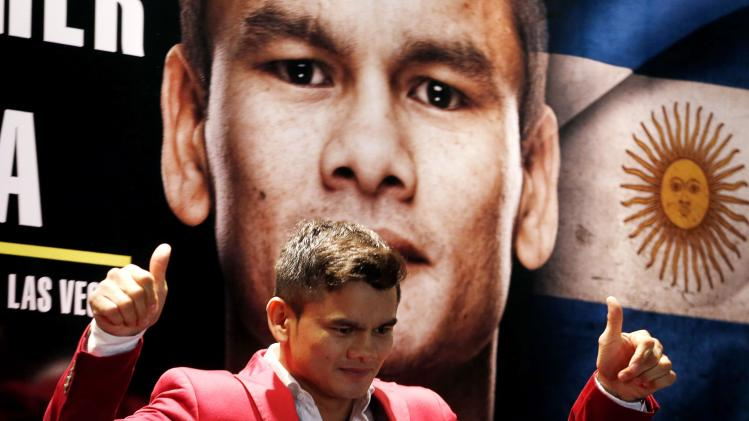 Maidana, current WBA Welterweight champion poses before a news conference in Buenos Aires