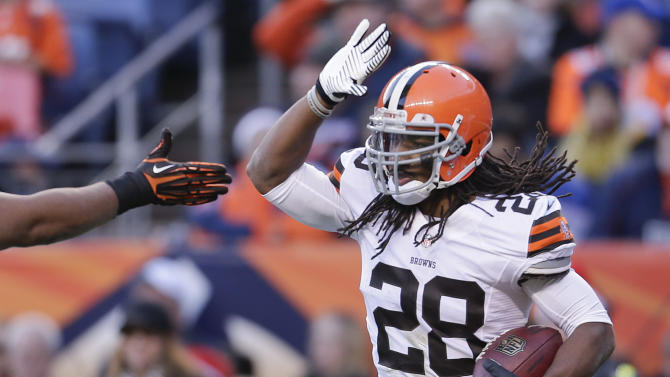 Cleveland Browns free safety Usama Young (28) is congratulated after intercepting a pass by Dener Broncos quarterback Peyton Manning in the end zone  during the second quarter of an NFL football game, Sunday, Dec. 23, 2012, in Denver. (AP Photo/Joe Mahoney)