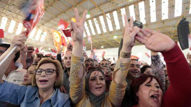 Supporters of Beji Caid Essebsi, presidential candidate and leader of Tunisia's secular Nidaa Tounes party, attend a campaign event in Sfax