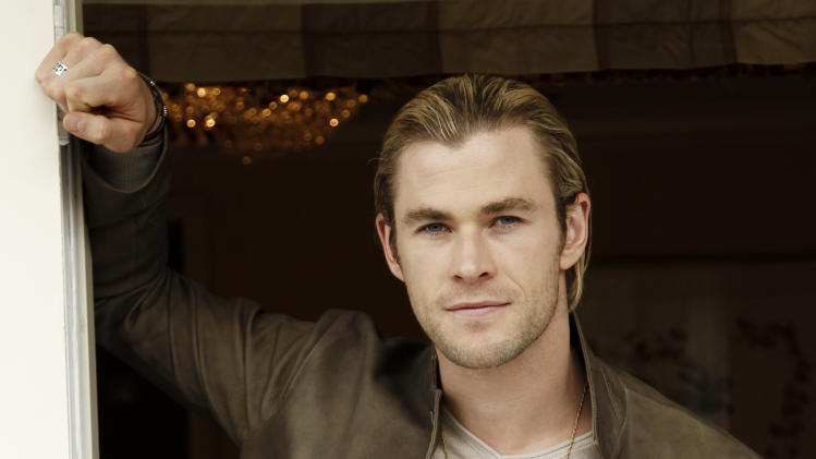 """In this April 12, 2012 photo, cast member Chris Hemsworth, who portrays Thor in the upcoming film """"The Avengers"""", poses for a portrait in Beverly Hills, Calif. The film will be released in theaters May 4. (AP Photo/Matt Sayles)"""