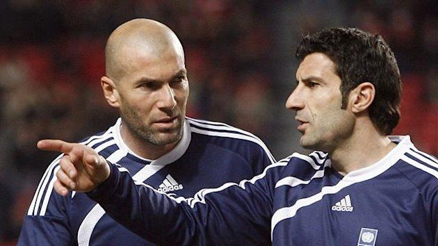 Luis Figo (R) of Portugal talks with Zinedine Zidane of France (Reuters)