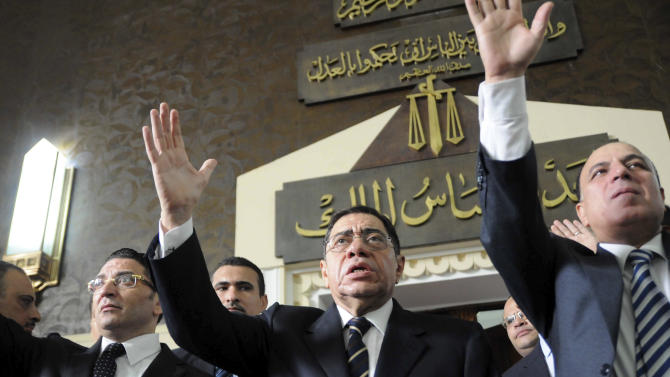 FILE - In this Saturday, Oct. 13, 2012 file photo, Egyptian Prosecutor General Abdel-Meguid Mahmoud addresses hundreds of supporters, judges, lawyers and media, not shown, in a downtown courthouse defying a presidential decision to remove him from his post, saying this infringes on the judiciary's independence, in Cairo, Egypt. An Egyptian appeals court on Wednesday, March 27, 2013 annulled a presidential decree appointing the top prosecutor in a new challenge by the judiciary to Islamist President Mohammed Morsi that throws the country's legal system into confusion. The dispute is rooted in a series of controversial decrees Morsi issued in November that sparked widespread protests. In them, he decreed that the prosecutor general could serve in office for only four years, with immediate effect on the post's holder at the time Abdel-Meguid Mahmoud, in place since 2006. (AP Photo/Mohmmed Asad, File)