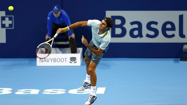 Switzerland's Roger Federer serves the ball during his match against Adrian Mannarino of France at the Swiss Indoors ATP tennis tournament in Basel (Reuters)