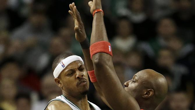 Boston Celtics forward Paul Pierce, left, collides with Los Angeles Clippers forward Lamar Odom, right, while passing the ball in the first quarter of an NBA basketball game at the TD Garden in Boston, Sunday, Feb. 3, 2013. (AP Photo/Steven Senne)
