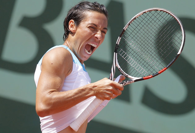Francesca Schiavone of Italy screams after marking a point in her third round match against Varvara Lepchenko of the U.S. at the French Open tennis tournament in Roland Garros stadium in Paris, Saturd