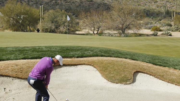 Martin Kaymer hits out of the bunker onto the 17th green in the second round of play during the Match Play Championship golf tournament, Friday, Feb. 22, 2013, in Marana, Ariz. (AP Photo/Ross D. Franklin)