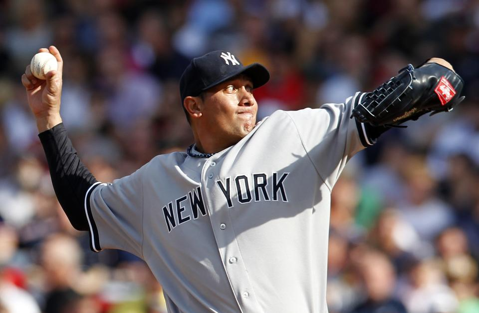 New York Yankees' Freddy Garcia pitches in the first inning of a baseball game against the Boston Red Sox in Boston, Saturday, April 21, 2012. (AP Photo/Michael Dwyer)