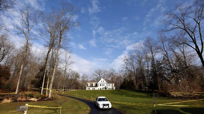 A police cruiser sits in the driveway as crime scene tape surrounds the home of Nancy Lanza, Tuesday, Dec. 18, 2012, in Newtown, Conn.  Nancy Lanza was killed by her son Adam Lanza before he forced his way into Sandy Hook Elementary School in Newtown Friday and opened fire, killing many others, including 20 children. (AP Photo/Jason DeCrow)
