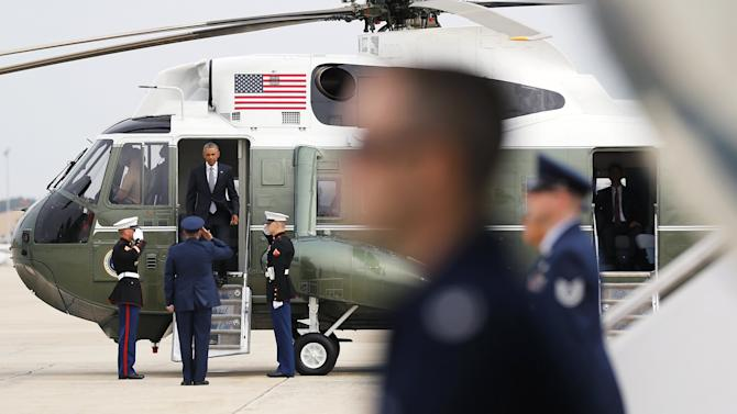 Obama arrives to board Air Force One for travel to Alaska from Joint Base Andrews