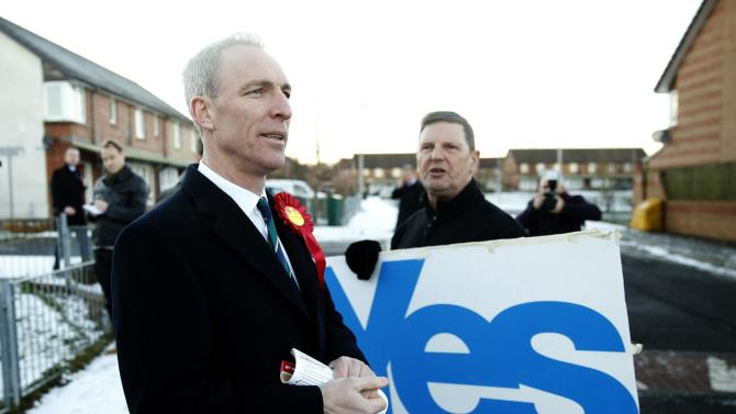 Scotland's Labour Party leader Jim Murphy is heckled by a Yes voter while campaigning in Dundee, Scotland