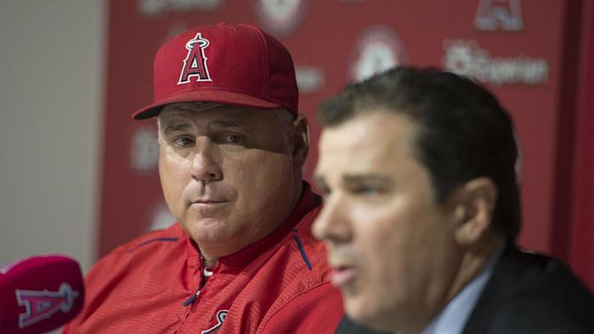 Los Angeles Angels president John Carpino, right, speaks as manager Mike Scioscia listens during a news conference following the Angels' baseball game against the New York Yankees, Wednesday, July 1, 2015, in Anaheim, Calif. The two were on hand to talk about the abrupt resignation of general manager Jerry Dipoto, earlier in the day. (Kevin Sullivan/The Orange County Register via AP)   MAGS OUT; LOS ANGELES TIMES OUT; MANDATORY CREDIT