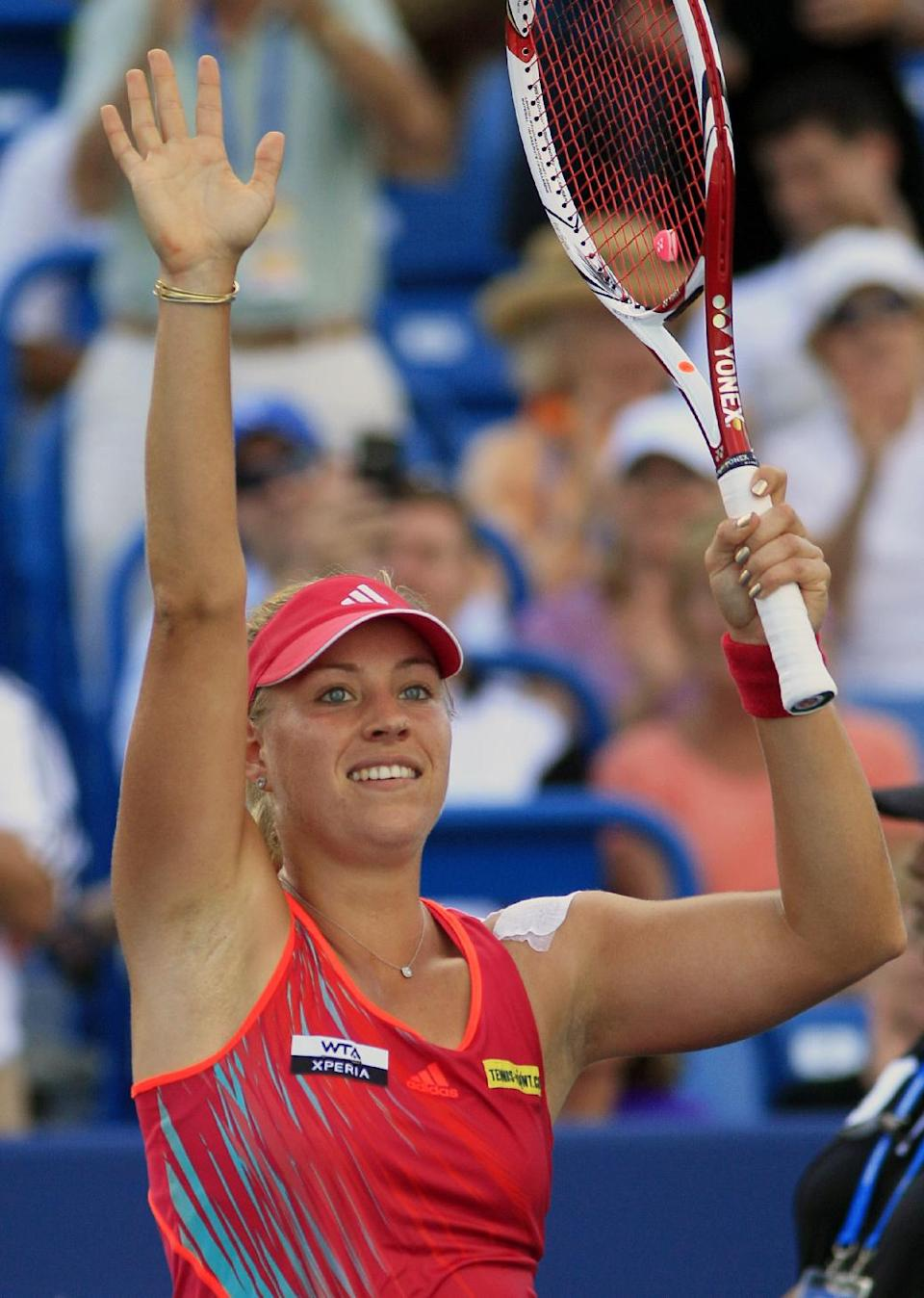 Angelique Kerber, from Germany, acknowledges the crowd after defeating Serena Williams 6-4, 6-4 in a quarterfinal at the Western & Southern Open tennis tournament on Friday, Aug. 17, 2012, in Mason, Ohio. (AP Photo/Al Behrman)