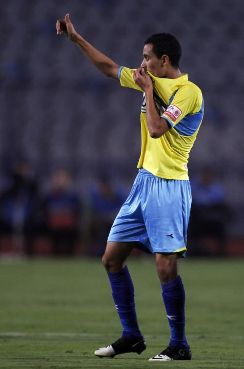 Ibrahim Hassan of El Ismaily celebrates after scoring a goal against El Zamalek during their opening Egyptian Premier League derby soccer match at Cairo Stadium