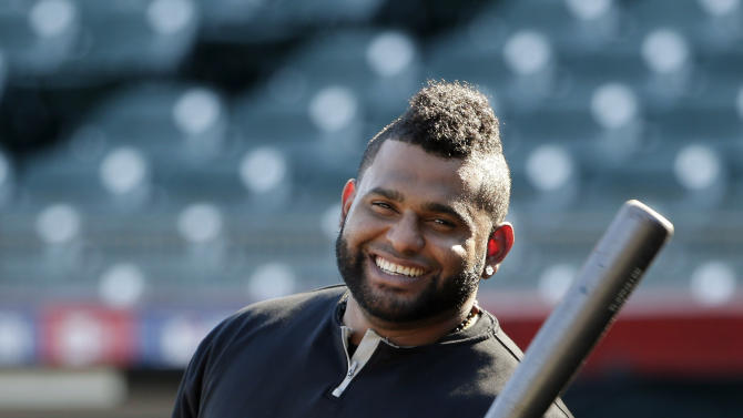 FILE - In this Oct. 18, 2014, file photo, San Francisco Giants third baseman Pablo Sandoval smiles as he takes batting practice during a team workout in San Francisco. Sandoval and the Boston Red Sox have agreed to a multiyear contract, a person with knowledge of the deal said. The person spoke to The Associated Press on condition of anonymity Monday, Nov. 24, 2014,  because the Red Sox had not announced the agreement. (AP Photo/Marcio Jose Sanchez, File)