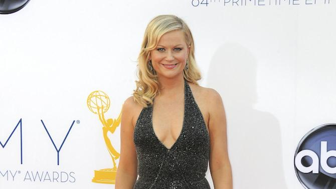 FILE - In this Sept. 23, 2012 file photo, actress Amy Poehler arrives at the 64th Primetime Emmy Awards at the Nokia Theatre, in Los Angeles. The Hollywood Foreign Press Association, dick clark productions and NBC announced Monday, Oct. 15, 2012, that Tina Fey and Amy Poehler, have signed on to host the 70th annual ceremony after British comedian Ricky Gervais' three-year reign as the ceremony's acerbic master of ceremonies. The Golden Globes are set to air on NBC on Jan. 13, 2013. (Photo by Jordan Strauss/Invision/AP, File)