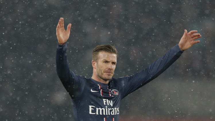 Paris Saint Germain's David Beckham waves at the end of their League One soccer match between PSG and Marseille at Parc des Princes Stadium, in Paris, Sunday Feb. 24, 2013. (AP Photo/Francois Mori)
