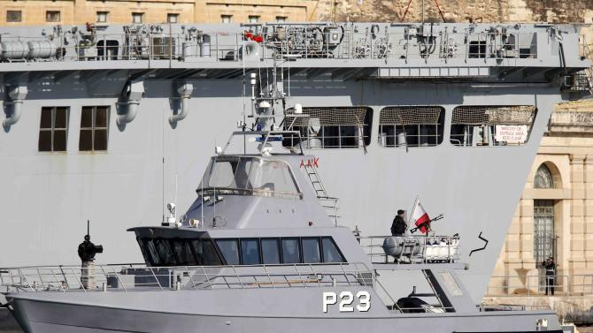 An Armed Forces of Malta boat patrols near the Royal Navy's HMS Bulwark amphibious assault ship in a harbour during the Commonwealth Heads of Government Meeting in Valletta