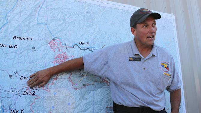 Deputy Incident Commander Pruett Small talks about the work firefighters have done to protect the community of Mogollon, N.M., during a briefing at base camp in Reserve, N.M., on Thursday, May 31, 2012. The Whitewater-Baldy fire has charred more than 190,000 acres to become the largest wildfire in New Mexico's recorded history. (AP Photo/Susan Montoya Bryan)
