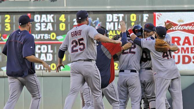 Teammates run to celebrate with Cleveland Indians closing pitcher Justin Masterson, second from right, after the Indians beat the Twins 5-1 in an MLB American League baseball game in Minneapolis, Sunday, Sept. 29, 2013, to clinch a wild card spot in the playoffs. (AP Photo/Ann Heisenfelt)