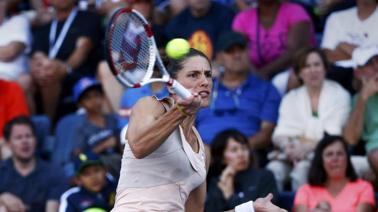 Andrea Petkovic of Germany hits a return to Caroline Wozniacki of Denmark during their match at the 2014 U.S. Open tennis tournament in New York