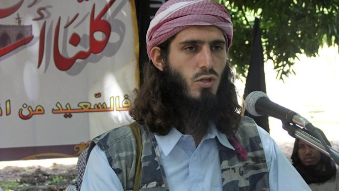 "FILE - In this Wednesday, May 11, 2011 file photo, American-born Islamist militant Omar Hammami addresses a press conference of the militant group al-Shabab at a farm in southern Mogadishu's Afgoye district in Somalia. Hammami, a jihadi from Alabama whose nom de guerre is Abu Mansoor Al-Amriki, or ""the American,"" and ascended the ranks of Somalia's al-Qaida-linked militant group al-Shabab high enough to attract a $5 million U.S. government bounty, was killed Thursday, Sept. 12, 2013 in an ambush ordered by the militant group's leader, militants said. (AP Photo/Farah Abdi Warsameh, File)"