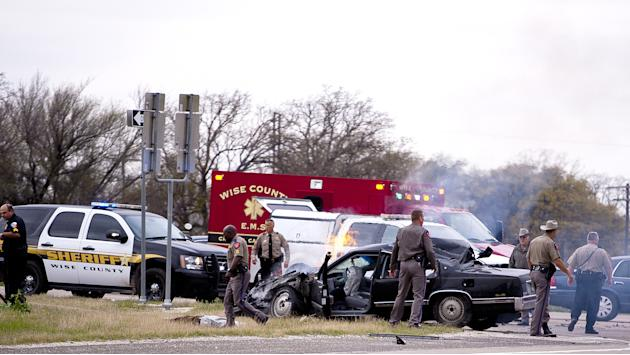Emergency personnel are on the scene of a crash and shootout with police involving the driver of a black Cadillac with Colorado plates in Decatur, Texas, Thursday, March 21, 2013. The driver led polic