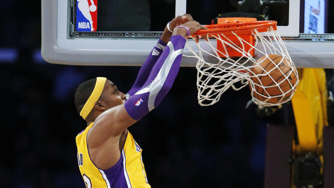 Los Angeles Lakers' Dwight Howard, top, dunks as San Antonio Spurs' Tiago Splitter (22), of Brazil, Stephen Jackson (3) and Tim Duncan watch in the first half of an NBA basketball game in Los Angeles, Tuesday, Nov. 13, 2012. (AP Photo/Jae C. Hong)
