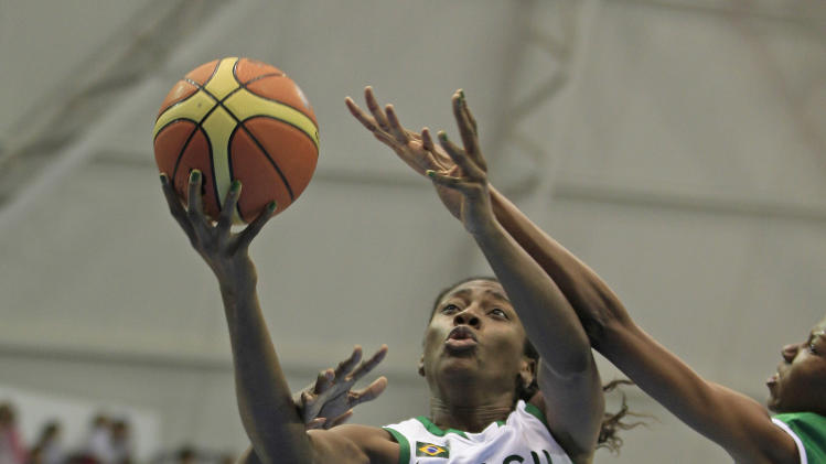 Brazil's Jaqueline Silvestre, center, goes to the basket over Jamaica's Ladonna Lamonth, left, and Shereel Brown during a women's basketball match at the Pan American Games in Guadalajara, Mexico, Saturday Oct. 22, 2011. (AP Photo/Martin Mejia)