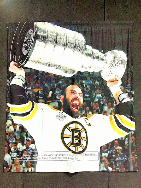 Zdeno Chara hoisting the Stanley Cup on poster on the side of a building in Boston