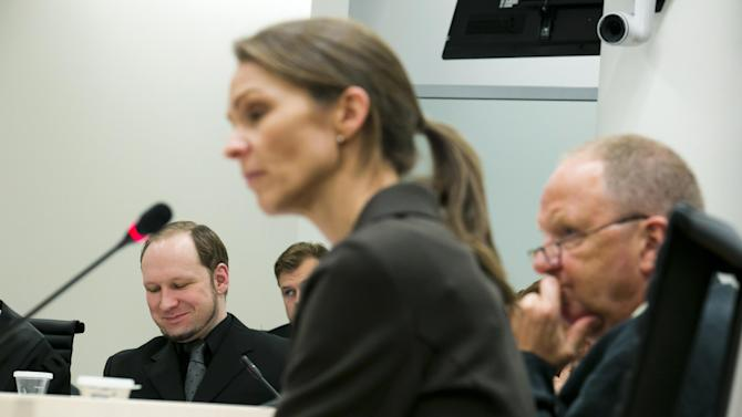 Synne Soerheim and Torgeir Husby, right, psychiatric experts who have found Anders Behring Breivik, seen at left background, psychotic at the time of his crimes, faced questioning by judges and lawyers in court Friday June 16, 2012.  The psychiatrist Soerheim, who have faced intense criticism for deeming Anders Behring Breivik, the self-confessed killer of 77 people in Norway last year, too mentally unfit to go to prison defended her stance Thursday, calling him delusional, and concluding that Breivik suffers from paranoid schizophrenia. (AP Photo/Heiko Junge, NTB scanpix, POOL)