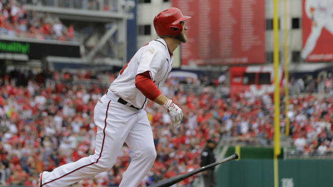 Washington Nationals left fielder Bryce Harper (34) watches his second homer of the game sail over right field in the fourth inning of the opening day baseball game against the Miami Marlins in Washington, on Monday, April 1, 2013.  (AP Photo/Alex Brandon)