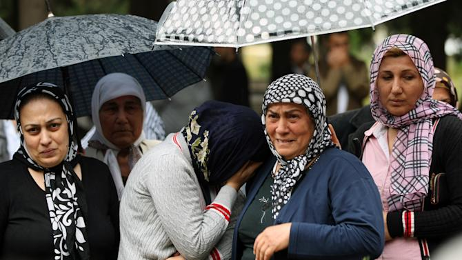 Mourning relatives cry as pallbearers carry the coffin of Fehmi Karaca, 69, a shop owner and one 46 victims killed in Saturday explosions, for burial in Reyhanli, near Turkey's border with Syria, Sunday, May 12, 2013. The bombings marked the biggest incident of cross-border violence since the start of Syria's bloody civil war and have raised fear of Turkey being pulled deeper into the conflict. (AP Photo/Burhan Ozbilici)