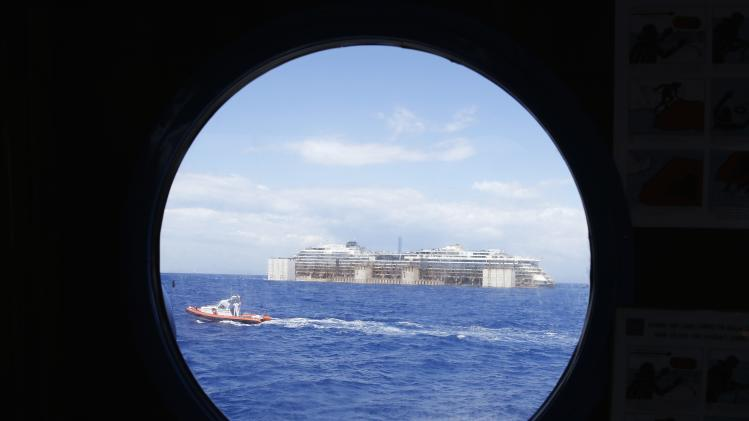 The cruise liner Costa Concordia is seen throughout porthole after leaving Giglio Island