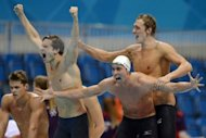 France&#39;s Clement Lefert, Amaury Leveaux and Fabien Gilot celebrate after winning the men&#39;s 4x100m freestyle relay final swimming event at the London 2012 Olympic Games at the Olympic Park in London