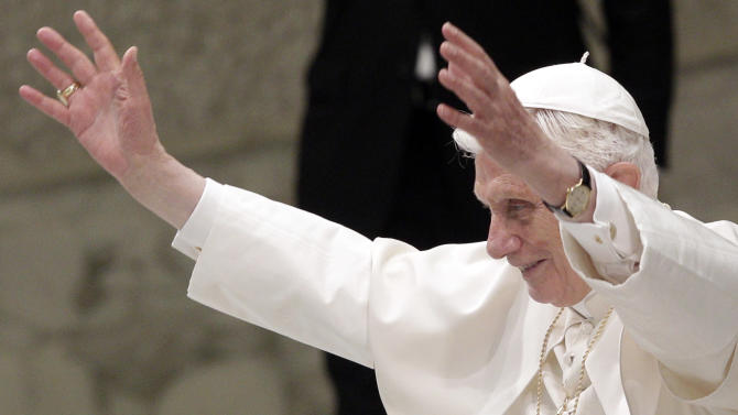 Pope Benedict XVI waves during an audience to newly appointed archbishops, the day after they received the pallium, a woolen shawl symbolizing their bond to the pope, at the Paul VI hall, Vatican, Saturday, June 30, 2012. (AP Photo/Riccardo De Luca)