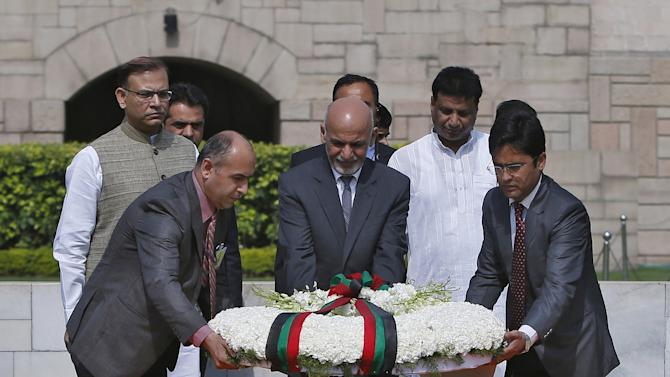 Afghanistan's President Ghani places a wreath at the Mahatma Gandhi memorial at Rajghat in New Delhi