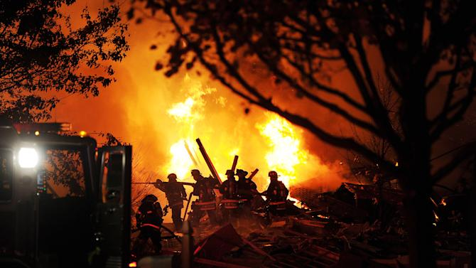 Authorities say a loud explosion has leveled a home in Indianapolis and set four others ablaze in a neighborhood, causing several injuries. Capt. Rita Burris with the Indiana Fire Department told The Associated Press that firefighters are still working to put out the flames after the explosion around 11 p.m. Saturday Nov. 10, 2012. (AP Photo/The Indianapolis Star, Matt Kryger)