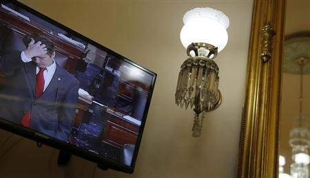 U.S. Senator Rand Paul (R-KY) appears on a television screen in an office at the U.S. Capitol as he filibusters on the Senate floor in opposition to the nomination of John Brennan to lead the CIA, in Washington, March 6, 2013. REUTERS/Jonathan Ernst