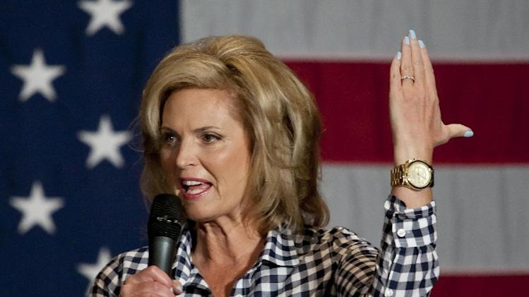 Ann Romney, wife of Republican Presidential candidate Mitt Romney, holds up her hand in the mitten shape of Michigan's lower peninsula while speaking at the Pinnacle Center in Hudsonville, Mich. on Friday, Oct. 12, 2012. (AP Photo/The Grand Rapids Press, Cory Morse)