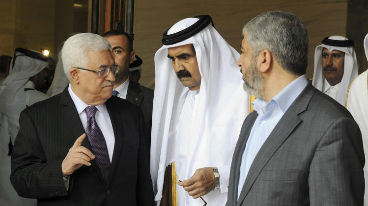 In this photo provided by by the Palestinian President's office, Palestinian President Mahmoud Abbas, left, and Khaled Mashal, chief of the Islamic militant group Hamas, right, confer with Qatar's crown prince Sheik Tamim Bin Hamad Al Thani, center, during a reconciliation meeting in Doha, Qatar, Monday, Feb. 6, 2012. The main Palestinian political rivals took a major step Monday toward healing their bitter rift, agreeing that Abbas would head an interim unity government to prepare for general elections in the West Bank and Gaza. (AP Photo/Thaer Ghanaim, Palestinian President's Office)