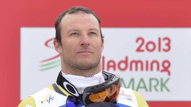 Norway's Aksel Lund Svindal listens to the national anthem during the flower ceremony for the men's downhill  at the Alpine skiing world championships in Schladming, Austria, Saturday, Feb. 9, 2013. (AP Photo/Kerstin Joensson)