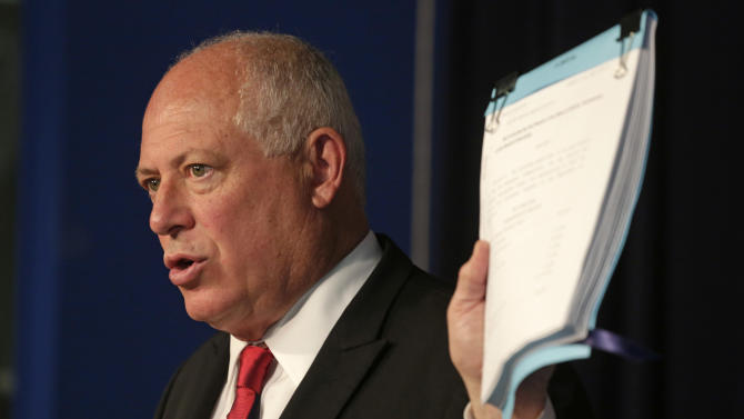 "Illinois Gov. Pat Quinn holds a budget bill that he said he would use his line-item veto on that would suspend Illinois lawmakers' pay during a new conference Wednesday, July 10, 2013, in Chicago. The Chicago Democrat is following through on his warning of consequences if the Legislature failed to end the state's nearly $100 billion pension crisis, the worst of any state nationwide. ""In this budget, there should be no paychecks for legislators until they get the job done on pension reform,"" Quinn said in a statement. ""Pension reform is the most critical job for all of us in public office. I cannot in good conscience approve legislation that provides paychecks to legislators who are not doing their job for the taxpayers."" (AP Photo/M. Spencer Green)"