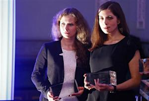 "Russian punk band Pussy Riot members Alyokhina and Tolokonnikova pose after winning a trophy in the category ""Most Valuable Documentary of the Year"" at the ""Cinema for Peace"" charity gala in Berlin"