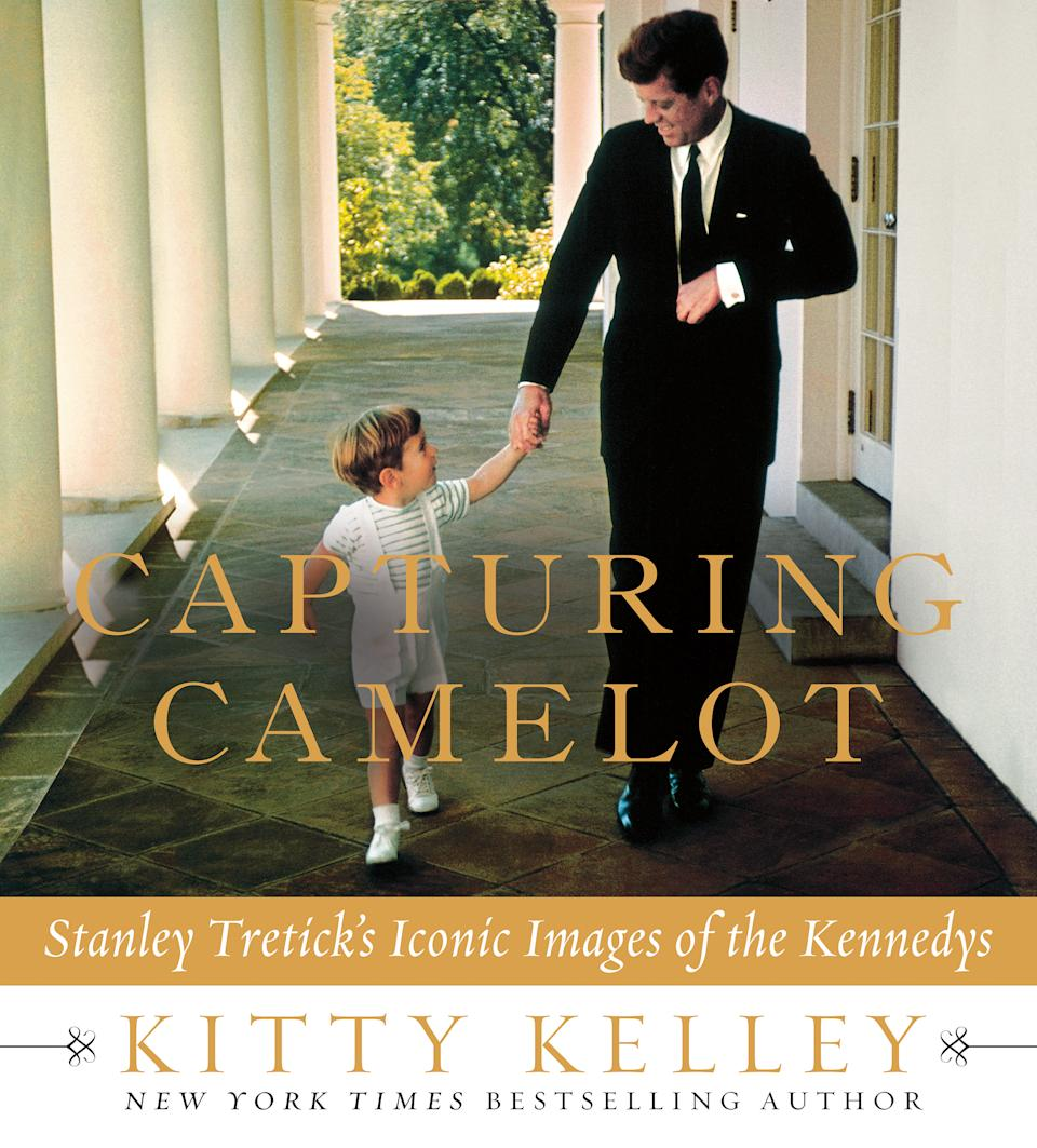 "This cover image released by Thomas Dunne Books shows ""Capturing Camelot: Stanley Tretick's Iconic Images of the Kennedys,"" by Kitty Kelley. The book features intimate images of John F. Kennedy by Kelley's close friend, photojournalist Stanley Tretick, who is known for his incredible access to the president and his family. (AP Photo/ Thomas Dunne Books)"