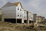 <p>               This Oct. 18, 2011 photo, shows new home construction in a development in Canonsburg, Pa. Americans bought slightly more new homes in October, but the median sales price fell to its lowest level this year. The mixed report suggests the nation's housing market is a long way from recovering. (AP Photo/Gene J. Puskar)