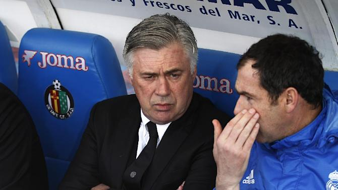 Real's coach Carlo Ancelotti talks with a colleague before a Spanish La Liga soccer match between Real Madrid and Getafe at the Coliseum Alfonso Perez stadium in Madrid, Spain, Sunday, Feb. 16, 2014