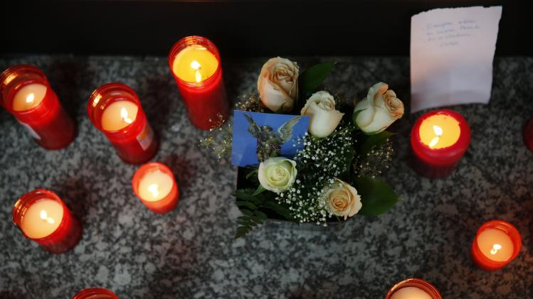Candles are placed on the floor at Madrid's Atocha station as memorial for the victims of the March 11, 2004 train bombings, in Madrid