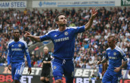 Chelsea's Frank Lampard, center, celebrates after scoring his third goal against Bolton Wanderers during their English Premier League soccer match in Bolton, England, Sunday Oct. 2, 2011. (AP Photo/Tim Hales)